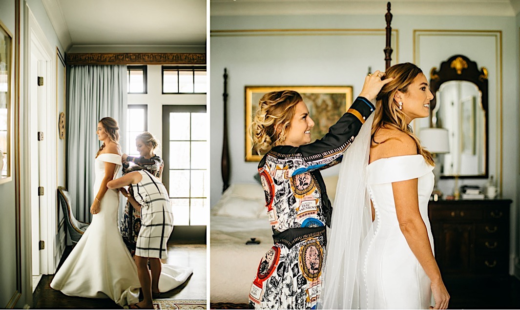A bride's family helps her get into her wedding dress.