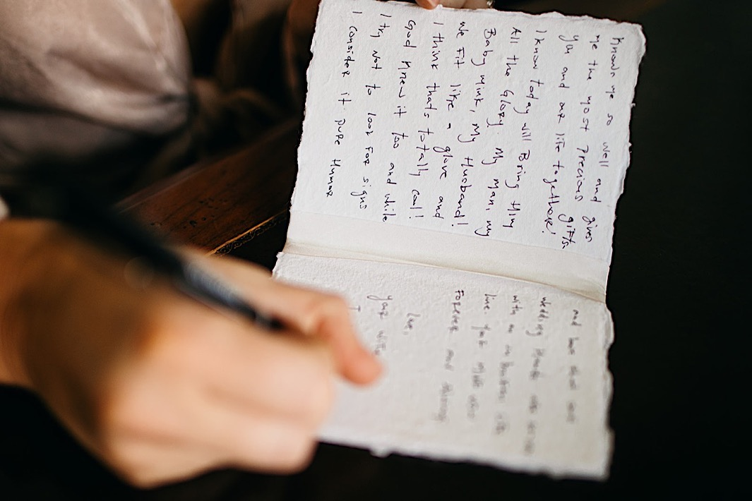 A bride writes a love note to her groom on their wedding day.