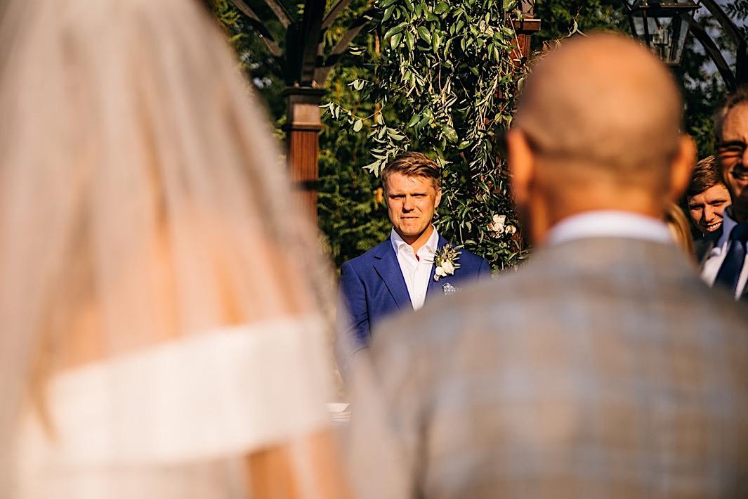 A groom cries as he sees his bride walk down the aisle.