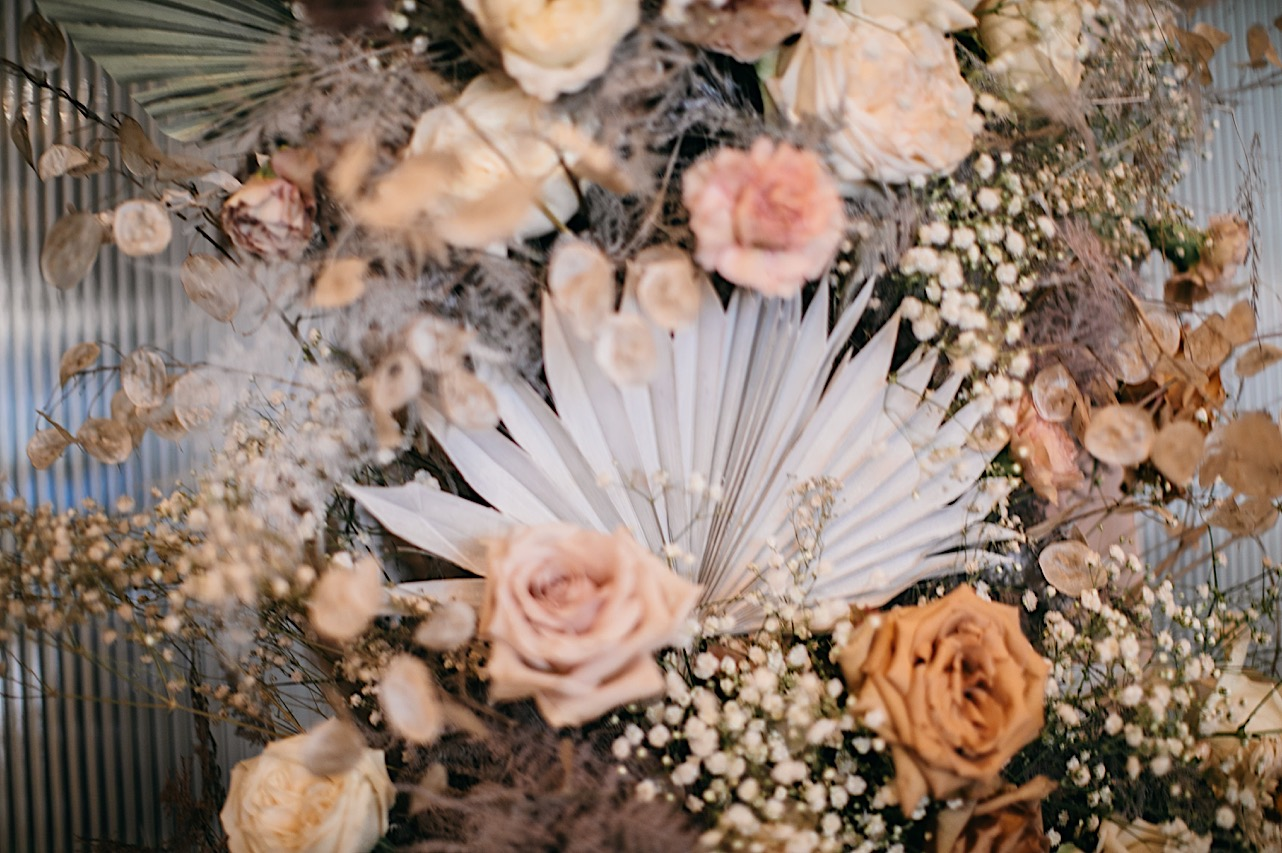 A blush pink and white dried floral arrangement by Fox & Fern Botanical Design.