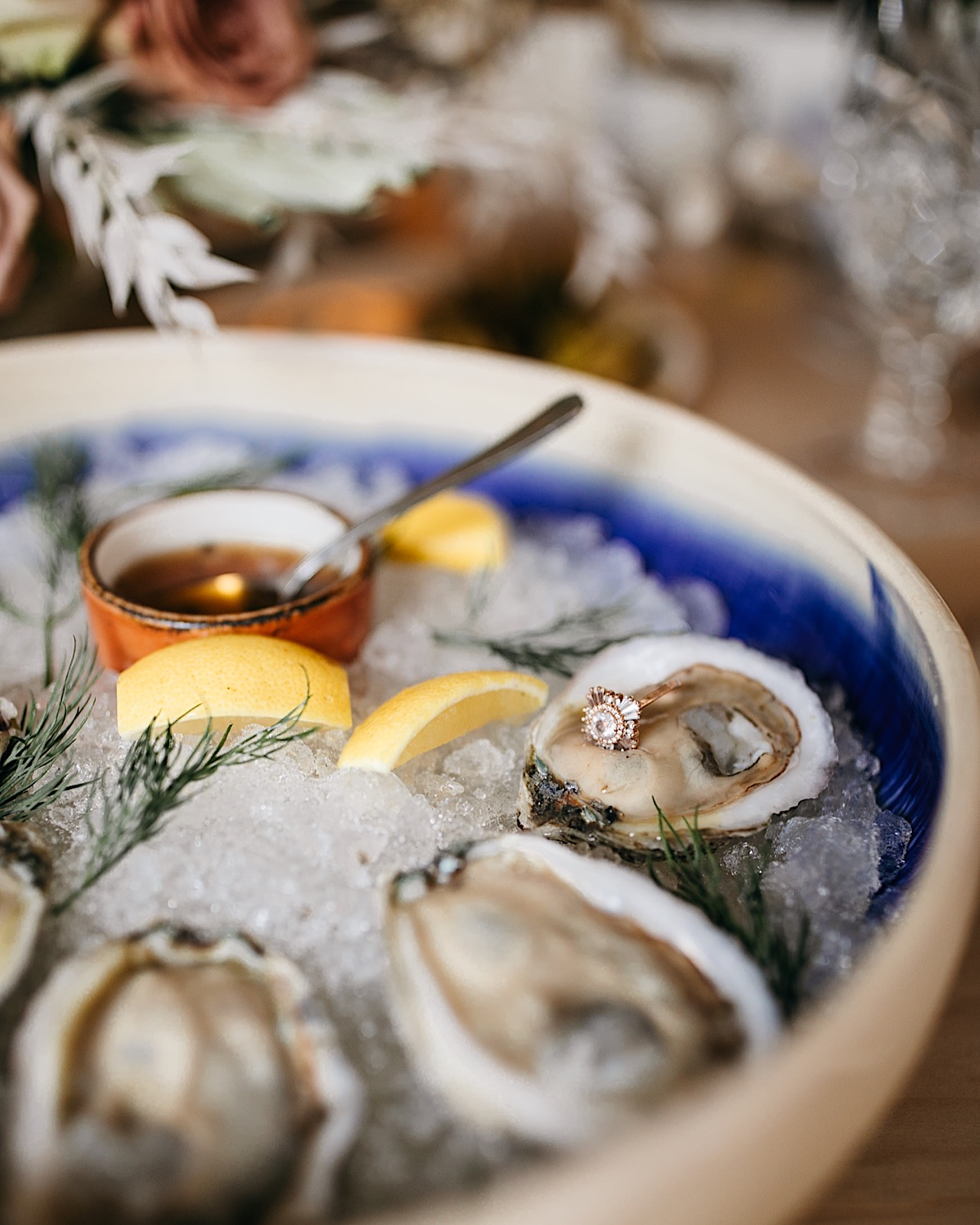 Oysters on a half shell on ice in a blue and white bowl at Easy Bistro & Bar.