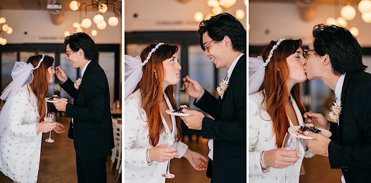 A groom feeds his bride a bite of chocolate dessert and then kisses her.