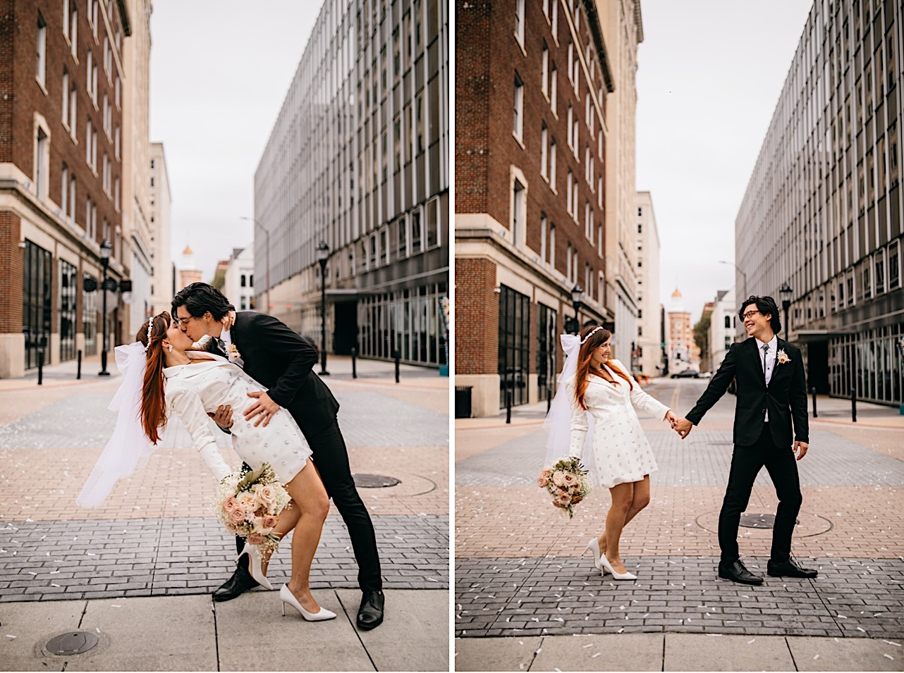 A bride and groom kiss in a downtown city street.