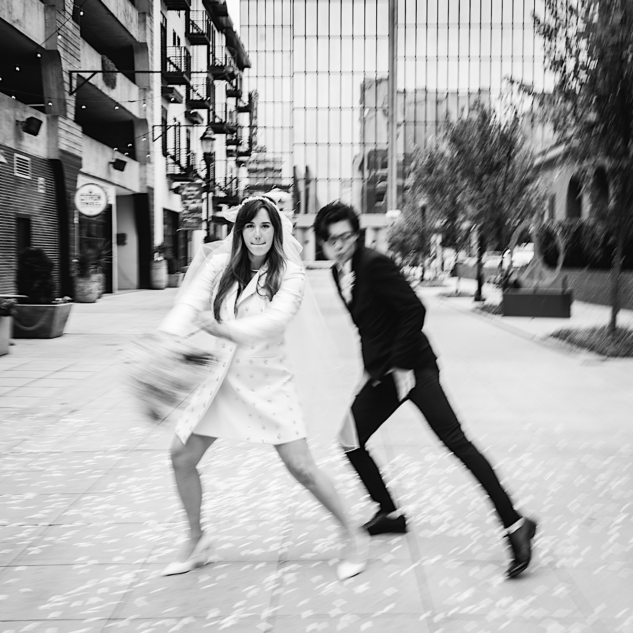A bride and groom strike a funny dance move in downtown Chattanooga.