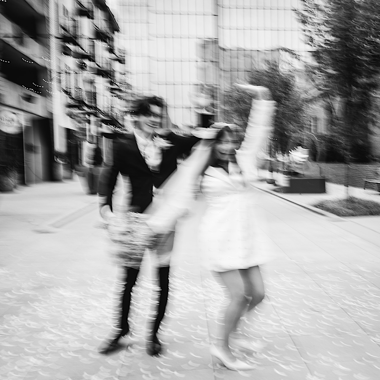 A black and white shot of a bride and groom dancing in downtown Chattanooga.