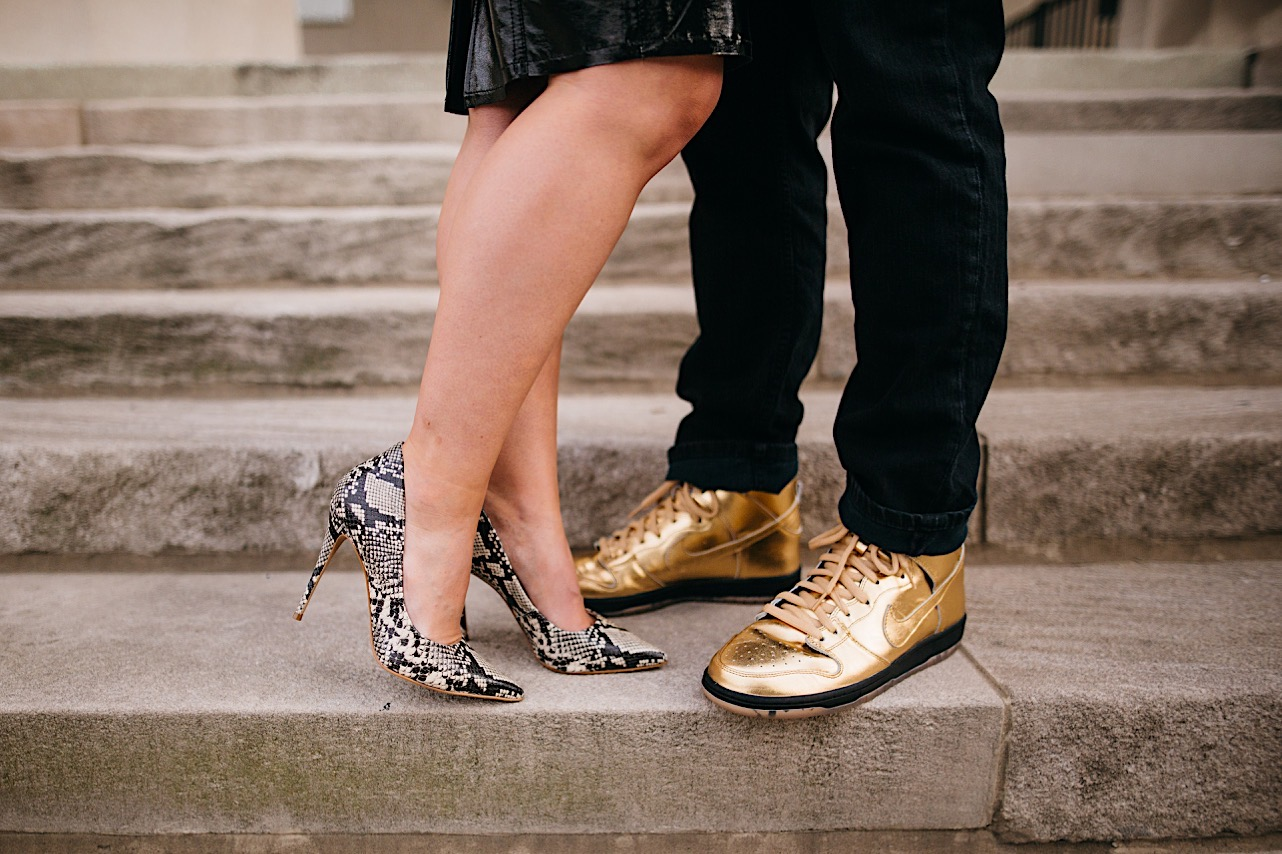 bride and groom showing their shoes on the steps of the courthouse at their halloween elopement
