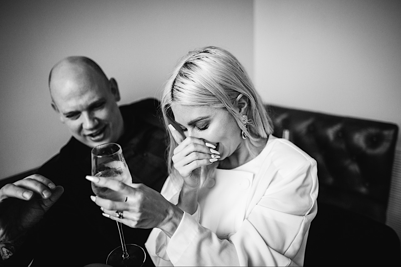 bride laughs at groom at their halloween elopement