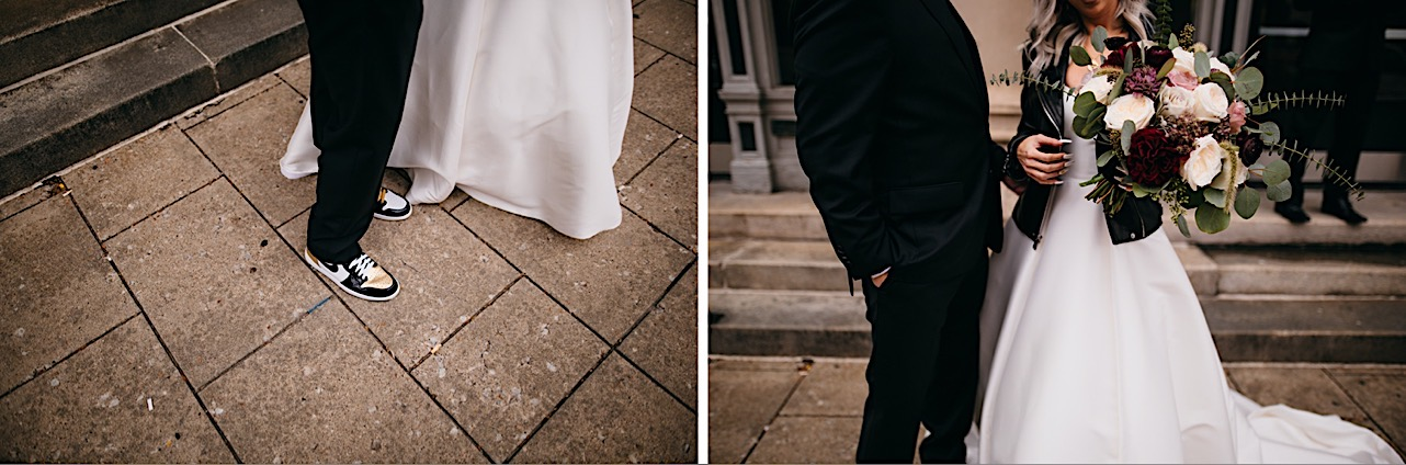 bride shows off her bouquet and leather jacket while husband shows off his Nike shoes at their halloween elopement