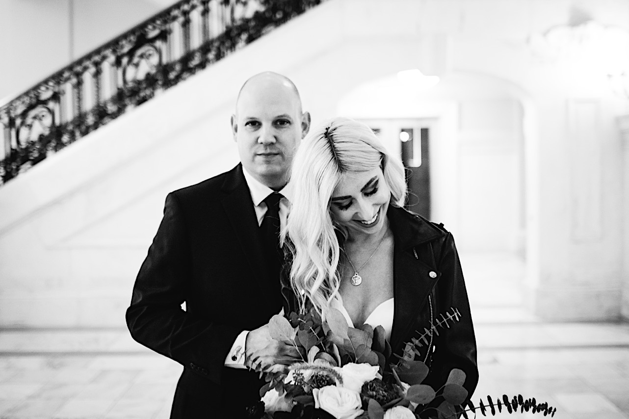 bride laughs at the groom at their halloween elopement
