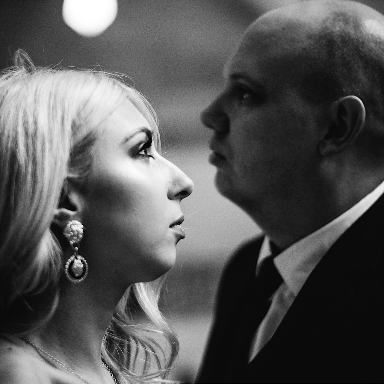 bride and groom stare off at their halloween elopement