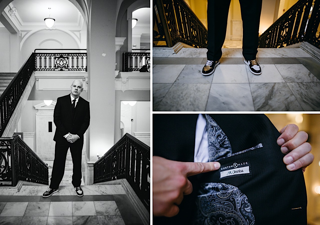 groom shows outfit details at his halloween elopement