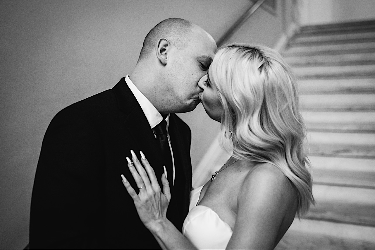 bride and groom kiss at their halloween elopement