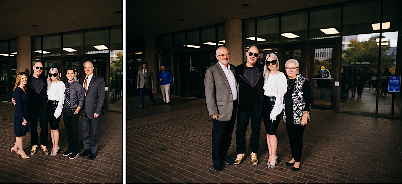 Halloween elopement at the courthouse where the bride and groom are wearing sunglasses and posing for a picture with their family