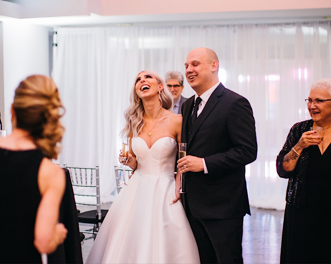 bride and groom share a laugh at their halloween elopement