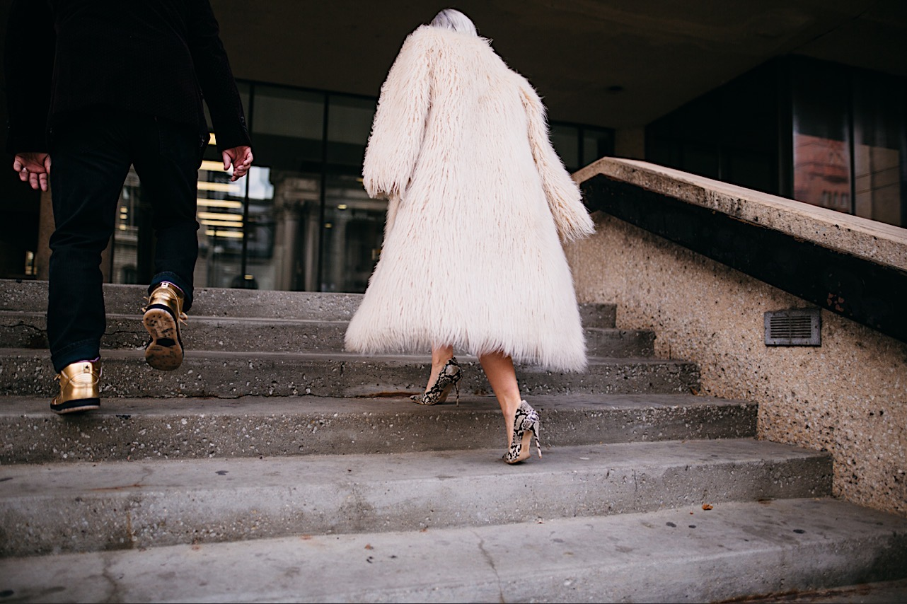 bride and groom are walking up the stairs of the courthouse at their halloween elopement