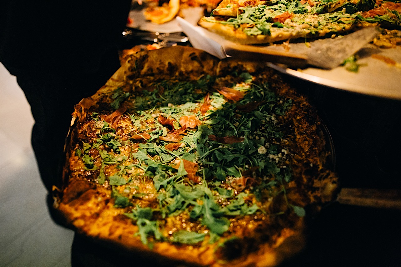 pizza is served at the bride and grooms halloween elopement