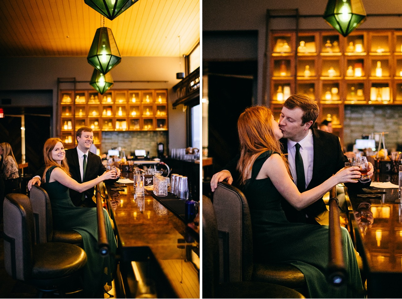 A couple drink together and laugh at a bar.