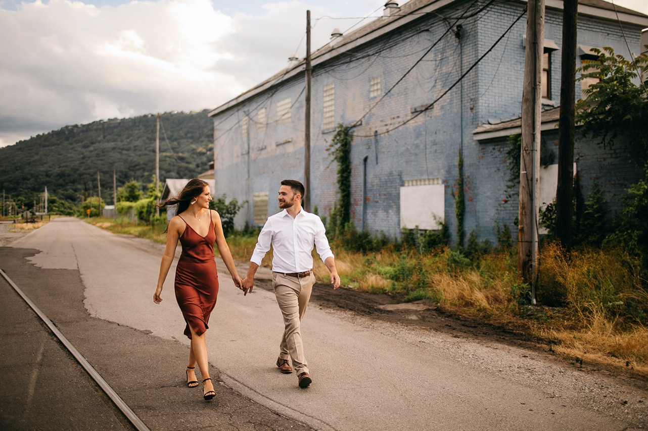 A couple walk hand-in-hand down a path at The Foundry in Chattanooga.