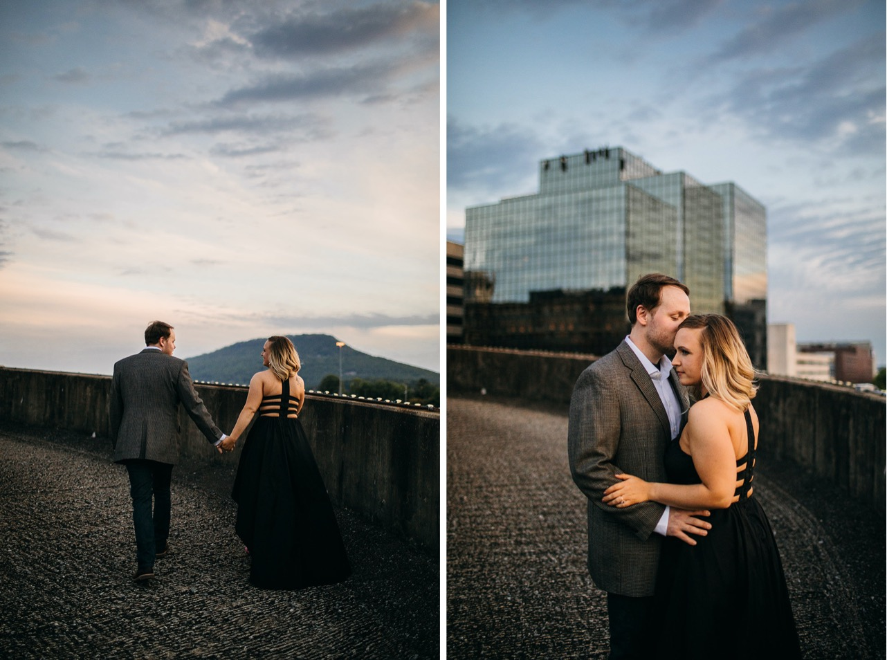 A man in a charcoal suit and his fiance in a black gown on a Chattanooga rooftop at sunset.
