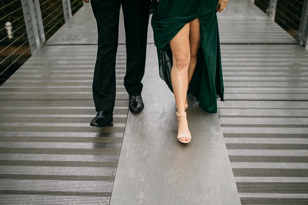 A close up shot of an engaged couple's feet as they walk on the Walking Bridge during their Chattanooga engagement photos.