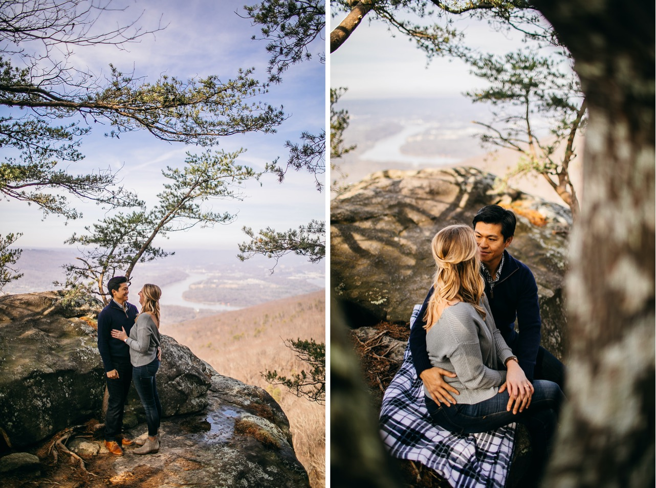 An engaged couple sits on a blue and white blanket on Sunset Rock.