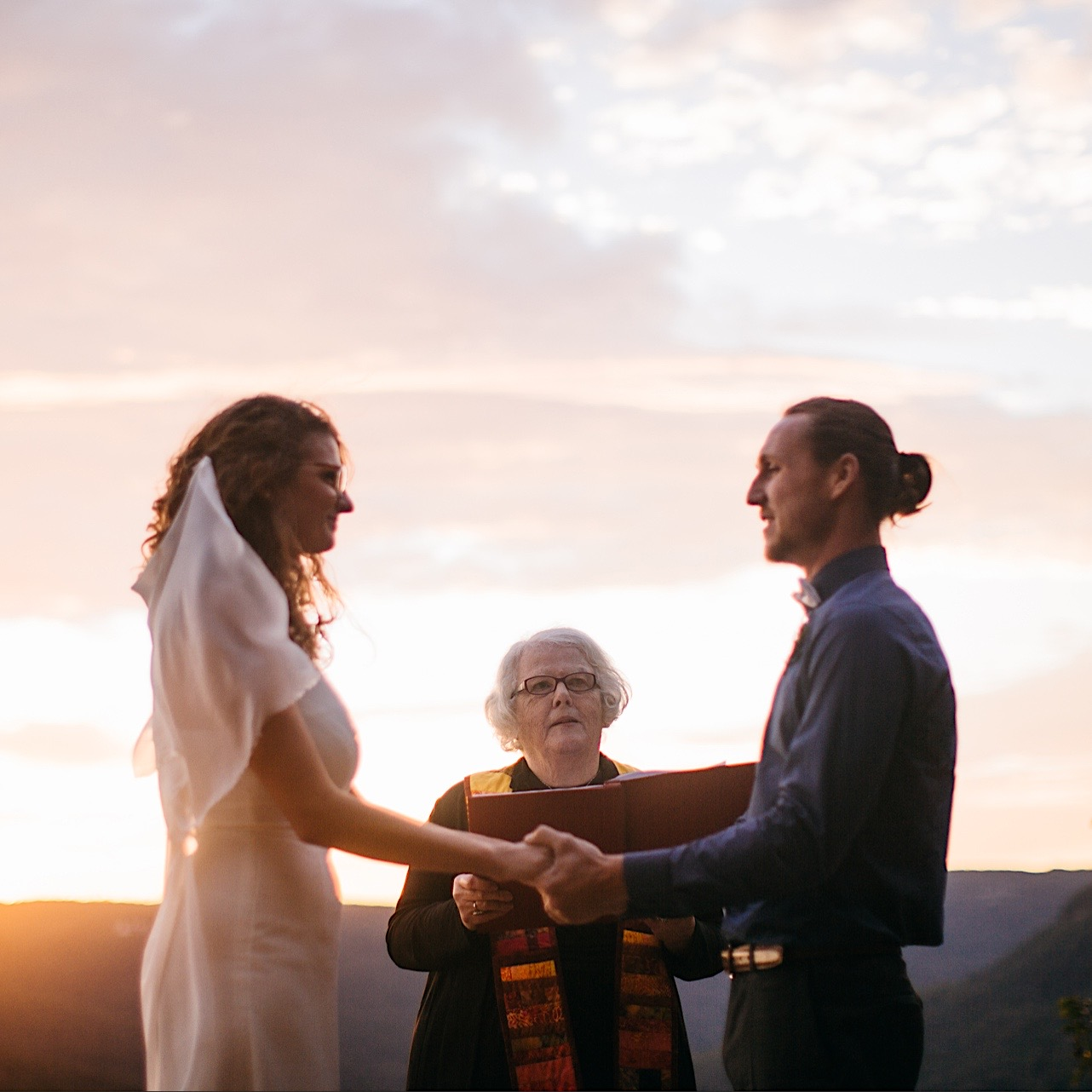 bride and groom say their vows during their sunrise elopement at Snooper's Rock