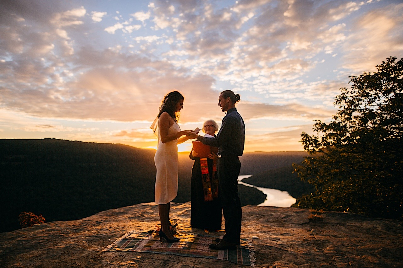 bride cries while reading her vows at her sunrise elopement