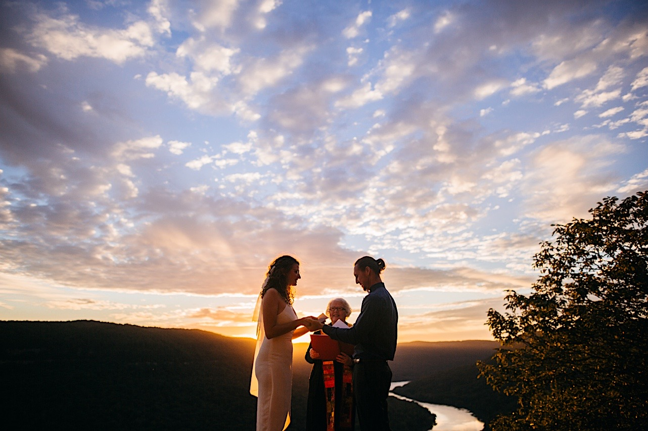 groom reads his vows during an elopement ceremony