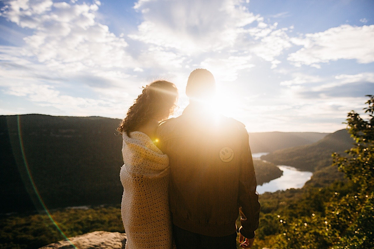 bride and groom admire the sunsire at their Snooper's Rock elopement