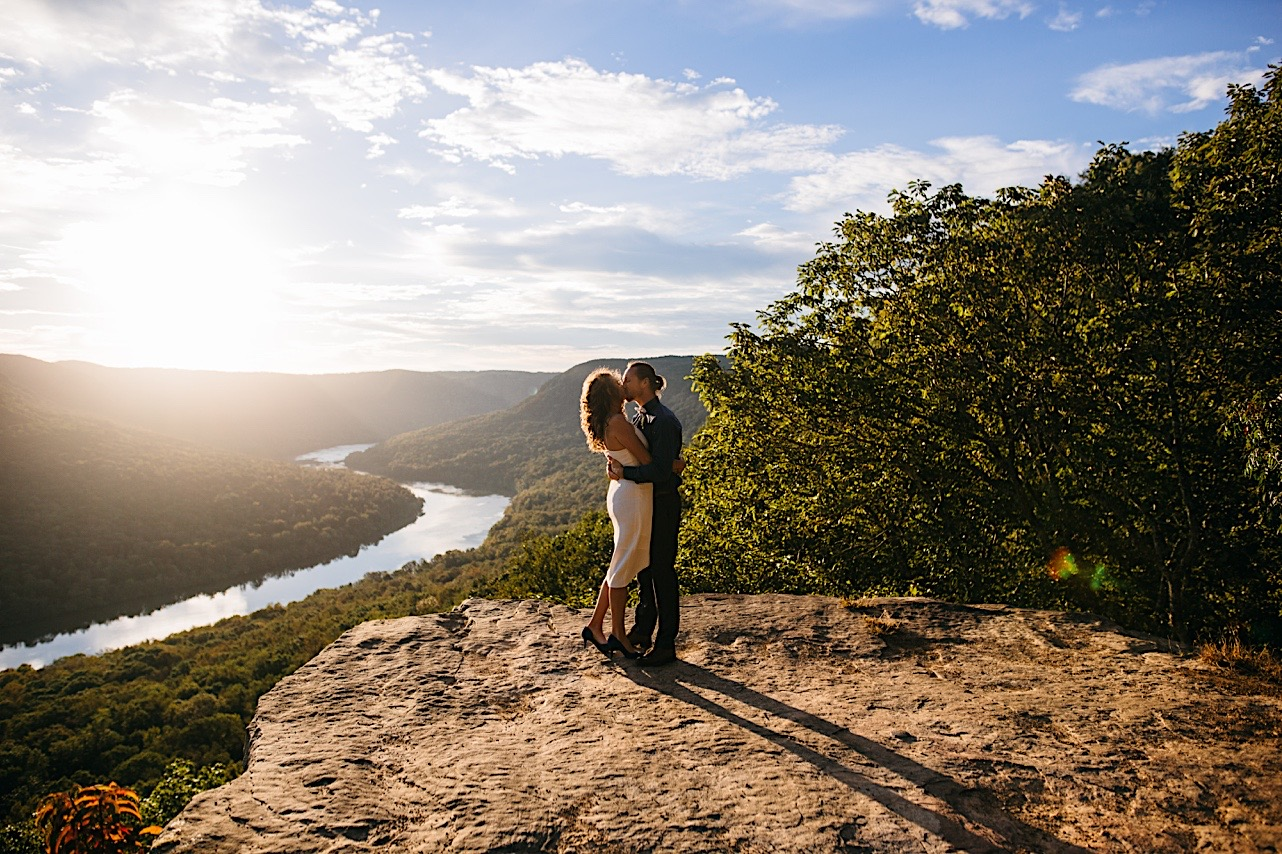 groom kisses bride as the sun rises at their elopement