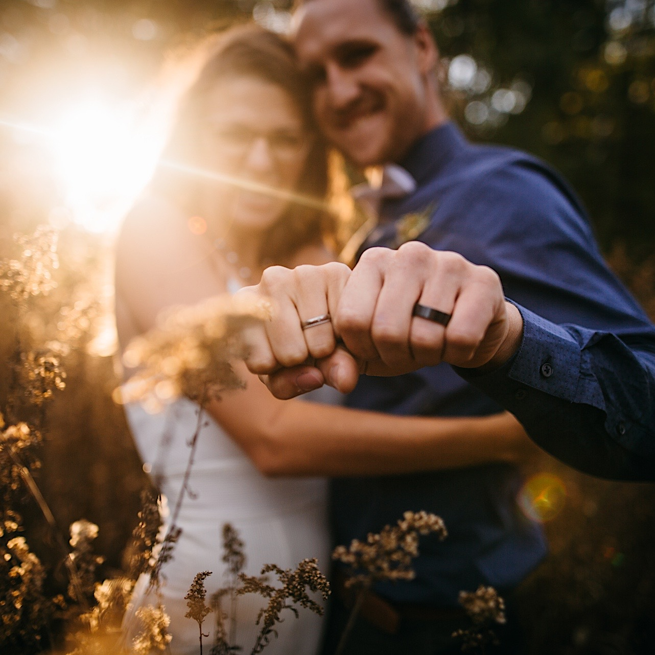bride and groom show off their wedding rings at their Snooper's Rock sunrise elopement