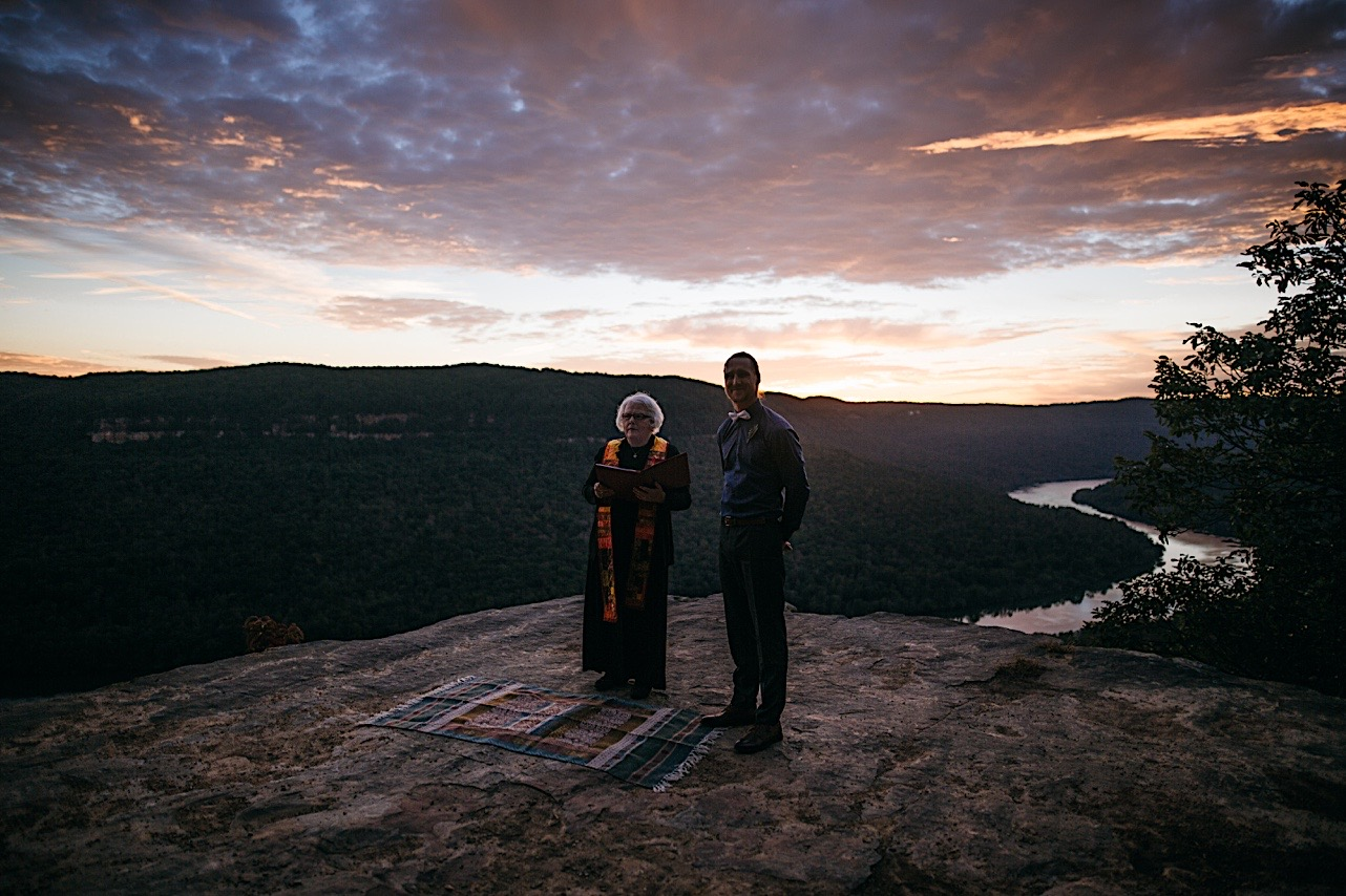 groom stands at the front of the ceremony for his Snooper's Rock sunrise elopement