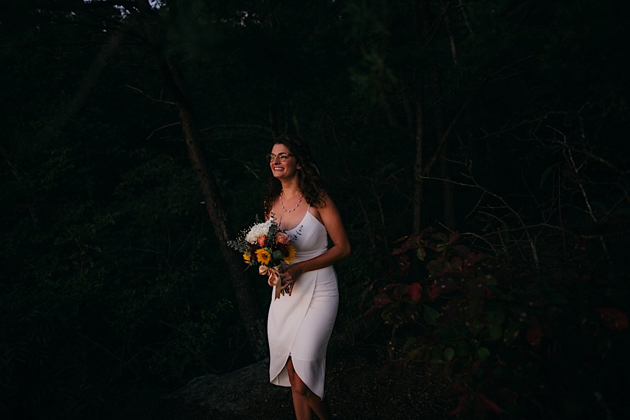 bride holds her bouquet while smiling